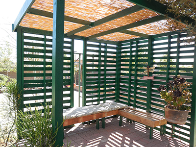 pallet pergola with benches and shade