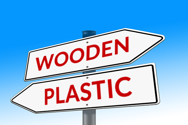 Sign displaying wooden vs plastic