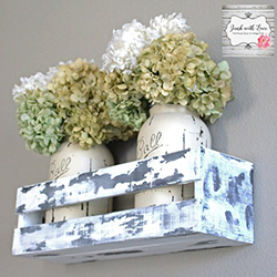 rustic chic window box with jars or flowers in it