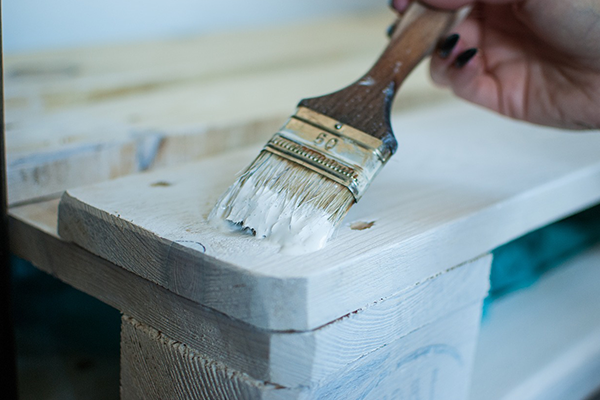Pallet being painted white