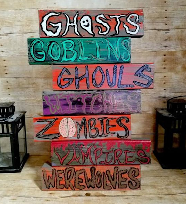 wooden pallet board sign with monsters