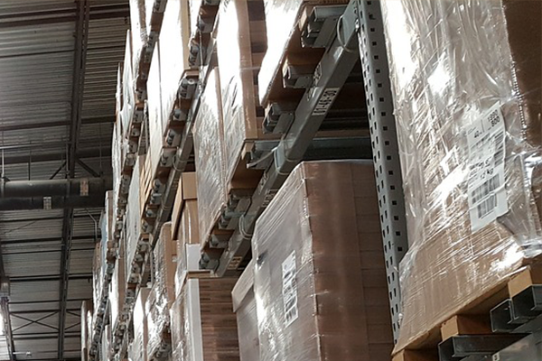 shrink wrapped goods on pallets in warehouse